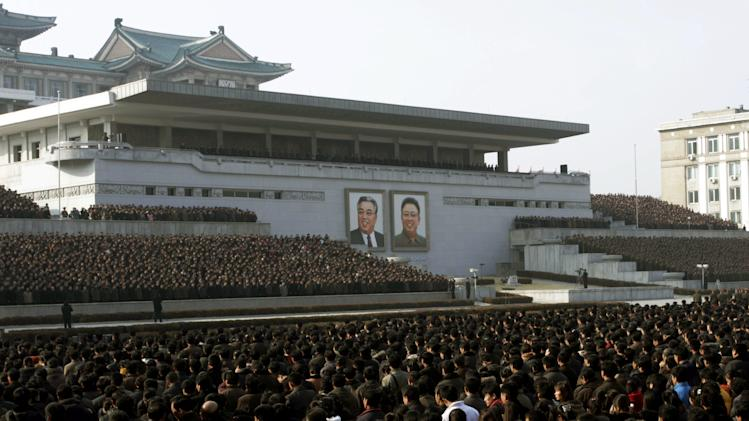 "North Koreans attend a rally in support of a statement given on Tuesday by a spokesman for the Supreme Command of the Korean People's Army vowing to cancel the 1953 cease-fire that ended the Korean War as well as boasting of the North's ownership of ""lighter and smaller nukes"" and its ability to execute ""surgical strikes""  meant to unify the divided Korean Peninsula, at Kim Il Sung Square in Pyongyang, North Korea, on Thursday, March 7, 2013. North Korea on Thursday vowed to launch a pre-emptive nuclear strike against the United States, amplifying its threatening rhetoric hours ahead of a vote by U.N. diplomats on whether to level new sanctions against Pyongyang for its recent nuclear test. (AP Photo/Jon Chol Jin)"