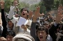 Afghans chant slogans during a demonstration in Kabul, Afghanistan, Wednesday, May, 22, 2013. More than 200 male students protested in front of Kabul University on Wednesday against a decree, which includes a ban on child marriage and forced marriage, making domestic violence a crime and saying that rape victims cannot be prosecuted for adultery.(AP Photo/Ahmad Jamshid)