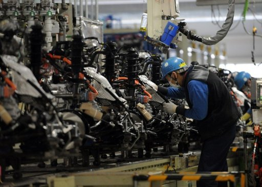 <p>Workers assemble engines at Toyota's Kanto Auto Works' Iwate plant in Iwate prefecture in March 2012. Japan's factory output fell 1.2 percent in July, the industry ministry said on Friday.</p>