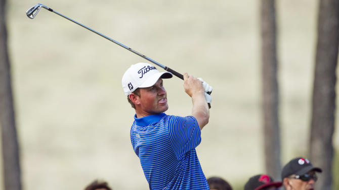 Webb Simpson follows his shot off the 11th tee during the first round of the Sony Open PGA Tour golf tournament, Thursday, Jan. 10, 2013, in Honolulu. (AP Photo/Marco Garcia)