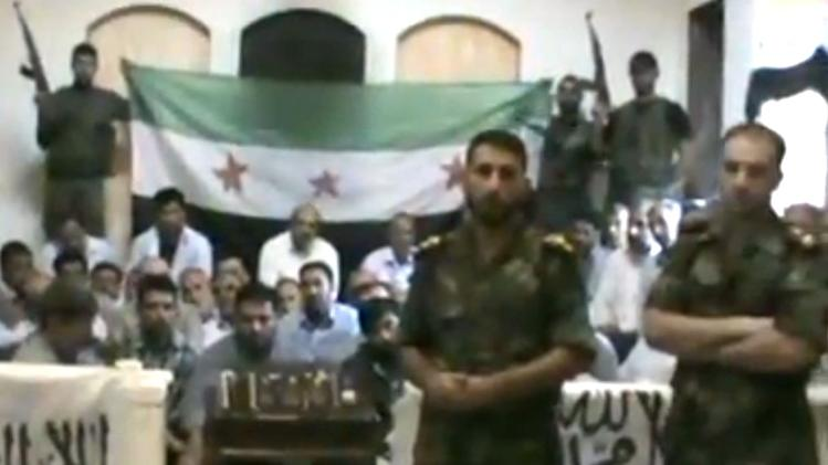 "This image made from a video released by the Baraa Brigades and accessed Sunday, Aug. 5, 2012, purports to show Free Syrian Army soldiers guarding a group of Iranians abducted a day earlier and promising more attacks on Iranian targets in Damascus, Syria. Armed men in the video identify themselves as members of the rebel ""Baraa Brigades"" and say that at least one of the 48 captives was an officer of Iran's powerful Revolutionary Guards. They claim that Iranians were on a ""reconnaissance mission"" in the capital Damascus at the time they were abducted. Iran says they are pilgrims who were visiting a shrine. (AP Photo/Baraa Brigades via AP video) THE ASSOCIATED PRESS IS UNABLE TO INDEPENDENTLY VERIFY THE AUTHENTICITY, CONTENT, LOCATION OR DATE OF THIS HANDOUT PHOTO"