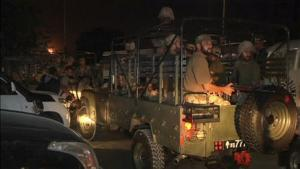 Soldiers sit in a vehicle at Jinnah International Airport in Karachi