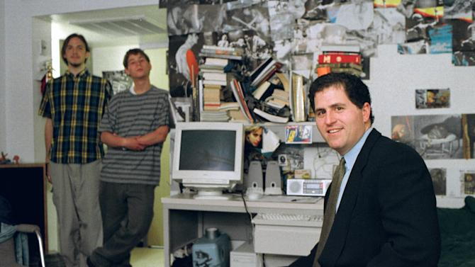 FILE - In this Friday, Feb. 26, 1999, file photo, Michael Dell, foreground, sits in the dorm room at the University of Texas in Austin, Texas, where he launched his enterprise as a college freshman. Michael Dell was the Mark Zuckerberg of his time. Hailed as a young genius, he created the inexpensive, made-to-order personal computer in his dorm room and peddled it to the masses. (AP Photo/Harry Cabluck, File)