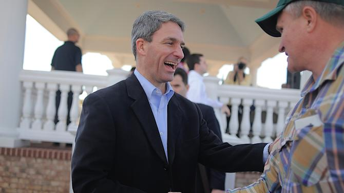 Ken Cuccinelli visits with a supporter during his campaign stop at the Courthouse Village at Spotsylvania Courthouse on Saturday Nov. 2, 2013, to campaign for the Governor's race in Virginia. (AP Photo/The Free Lance-Star, Suzanne Carr Rossi)