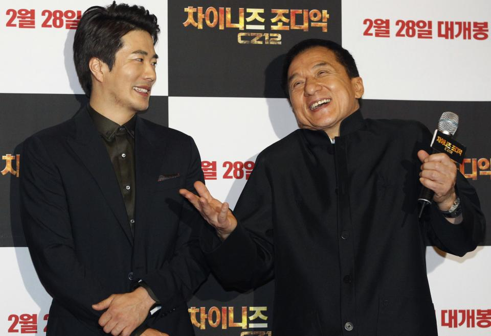 CORRECTS YEAR - Hong Kong actor and director Jackie Chan, right, and South Korean actor Kwon Sang-woo smile during a promotional event for their latest movie, CZ12, or Chinese Zodiac, in Seoul, South Korea, Monday, Feb. 18, 2013. (AP Photo/Ahn Young-joon)