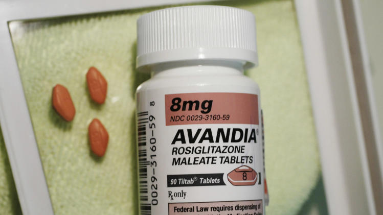 FILE - In this June 30, 2010 file photo, three Avandia pills are displayed near the bottle in Palo Alto, Calif. The Food and Drug Administration is reviewing a new interpretation of Avandia's heart attack risk, which suggests that the drug is as safe as older diabetes drugs. (AP Photo/Paul Sakuma, File)