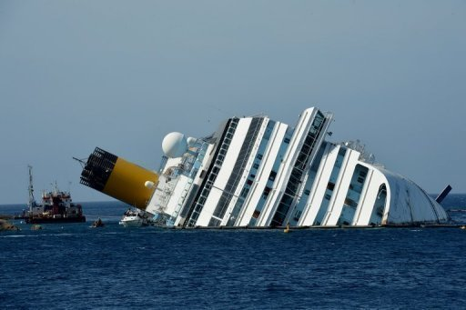 "<p>The stranded Costa Concordia cruise ship lies stranded near Giglio Porto harbour on June 25. The captain of an Italian cruise ship which crashed in January admitted in his first interview since the disaster that he was ""distracted"" but said the ""hand of God"" averted an even bigger tragedy.</p>"