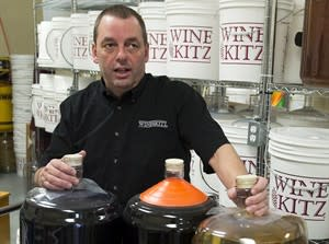 Ross Harrington, owner of Wine Kitz, stands in the winemaking section of his store in Halifax on Tuesday, Jan. 29, 2013. Harrington's operation offers on-site fermentation services to customers who buy kits for making wine and he is involved in a legal battle with the Nova Scotia Liquor Corporation. The corporation is requesting a court order to stop retailers from offering in-house beer and winemaking services, which are against provincial liquor laws. THE CANADIAN PRESS/Andrew Vaughan