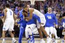 Kentucky players celebrate after a 68-66 win over Notre Dame in a college basketball game in the NCAA men's tournament regional finals, Saturday, March 28, 2015, in Cleveland. (AP Photo/David Richard)