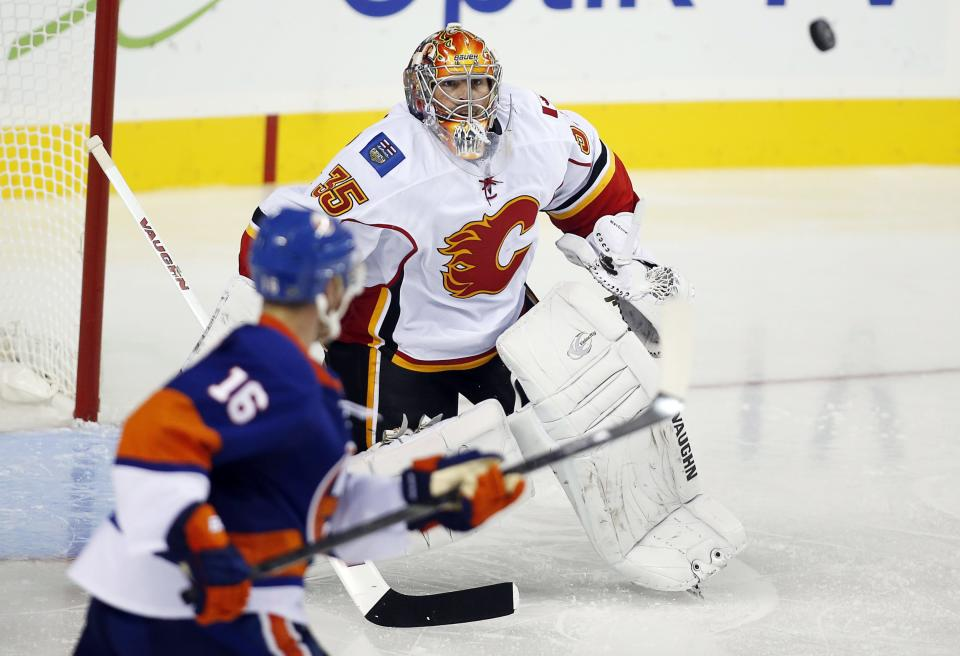 Wideman nets 2, Flames top Isles 5-3
