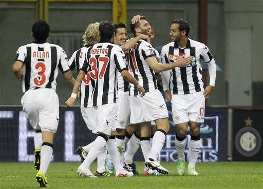 Udinese defender Maurizio Domizzi, second from right, celebrates with his teammates after scoring during the Serie A soccer match between Inter Milan and Udinese at the San Siro stadium in Milan, Ital