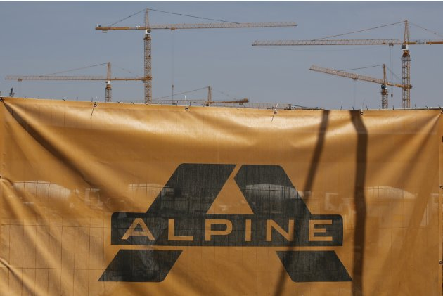 The logo of Austrian construction company Alpine is pictured next to a construction site in Vienna