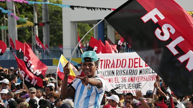 """A supporter of Nicaragua's President Daniel Ortega takes part in celebrations for the 36th anniversary of the """"Repliegue"""" (withdrawal) in Managua, Nicaragua"""