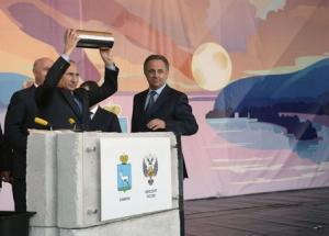 Russia's President Vladimir Putin addresses people as he visits a construction site of the stadium which is expected to host soccer matches of the 2018 World Cup, in the city of Samara