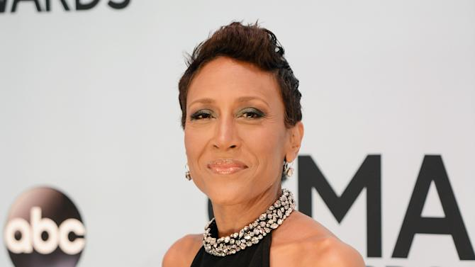 """FILE - This Nov. 6, 2013 file photo shows Robin Roberts at the 47th annual CMA Awards at Bridgestone Arena in Nashville, Tenn. Roberts will appear as a guest judge on ABC's """"Dancing With the Stars."""" The """"Good Morning America"""" anchor will appear on the show next Monday alongside the regular panelists. She's the first of several guest judges scheduled for this season, including Ricky Martin and Redfoo from the band LMFAO. (Photo by Evan Agostini/Invision/AP, File)"""