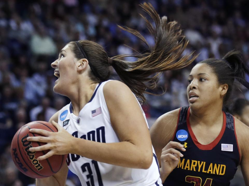 Connecticut center Stefanie Dolson pivots to the basket against Maryland forward Tianna Hawkins during the second half of an NCAA women's college basketball tournament regional semifinal in Bridgeport, Conn., Saturday, March 30, 2013. Connecticut won 76-50. (AP Photo/Charles Krupa)