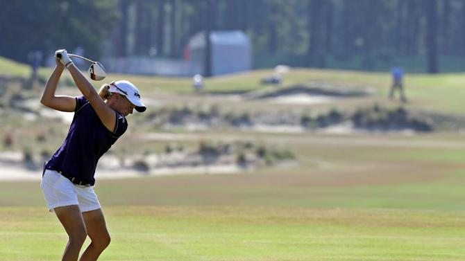 Stacy Lewis prepares to hit on the 14th hole during the first round of the U.S. Women's Open golf tournament in Pinehurst, N.C., Thursday, June 19, 2014. (AP Photo/Bob Leverone)