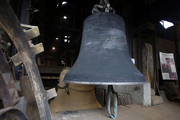 "A new bell bound for Notre Dame cathedral in Paris,""Gabriel"" is seen Friday, Dec. 7, 2012, after being cast in the foundry of Villedieu les Poeles, Normandy, France.  Paris' Notre Dame Cathedral will"