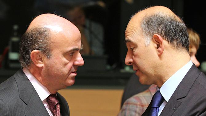 French Finance Minister Pierre Moscovici, right, talks with Spanish Finance Minister Luis de Guindos Jurado, at the EU finance ministers meeting, in Luxembourg, Tuesday Oct. 9, 2012. EU finance ministers assess the budgetary situation in Portugal and address the challenges of the European financial crisis. (AP Photo/Yves Logghe)