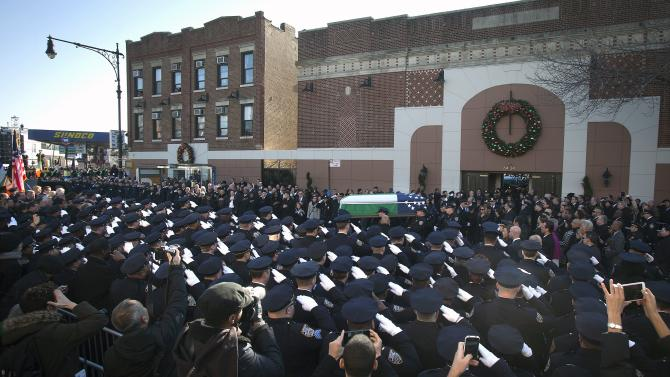 Police officers carry the casket of slain NYPD officer Ramos out of Christ Tabernacle Church to his final resting place during his funeral service in the Queens borough of New York