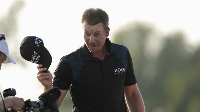 Stenson of Sweden waves at the camera after winning the DP World Tour Championship in Dubai
