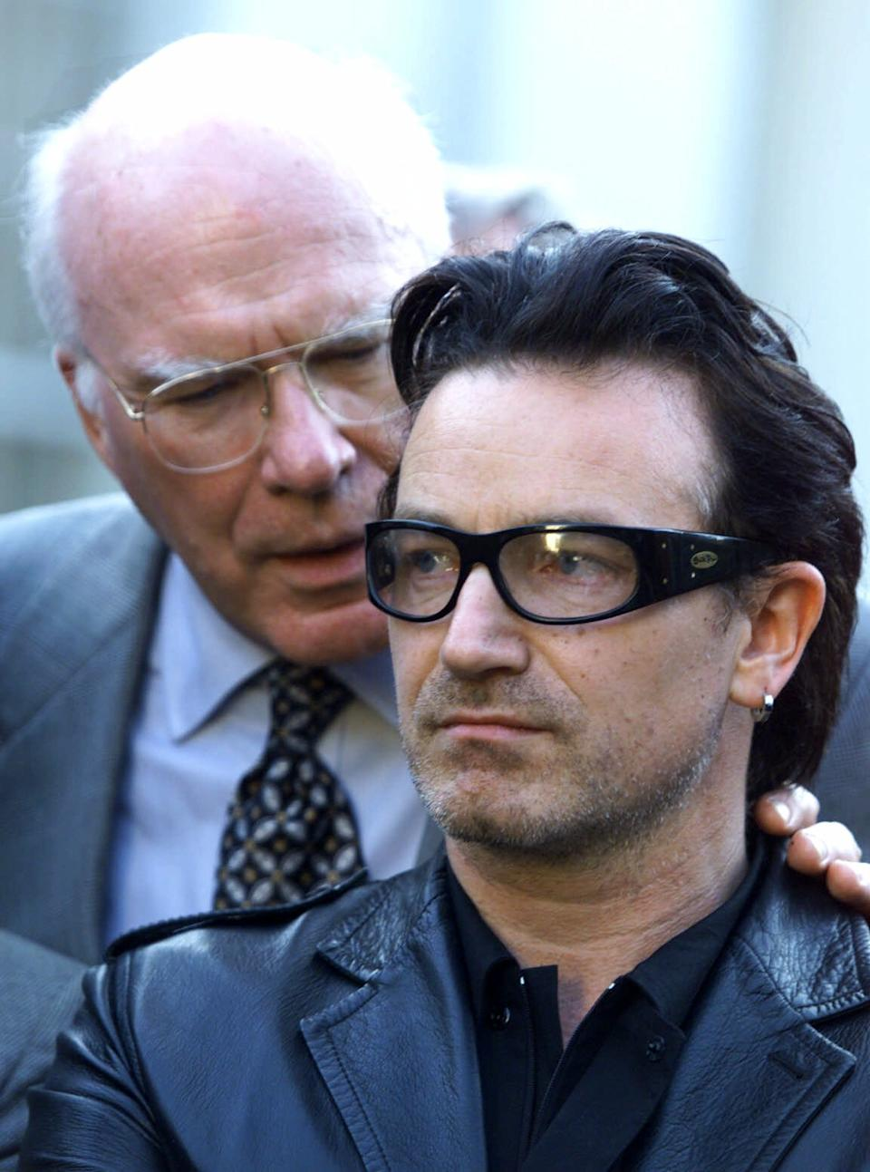 FILE -  This is a Oct. 2, 2000  file photo of Senator Patrick Leahy D-Vt., left, as he  talks to Bono a musician from the group U2 during a news conferece at the White House in Washington. (AP Photo/Joe Marquette, File)