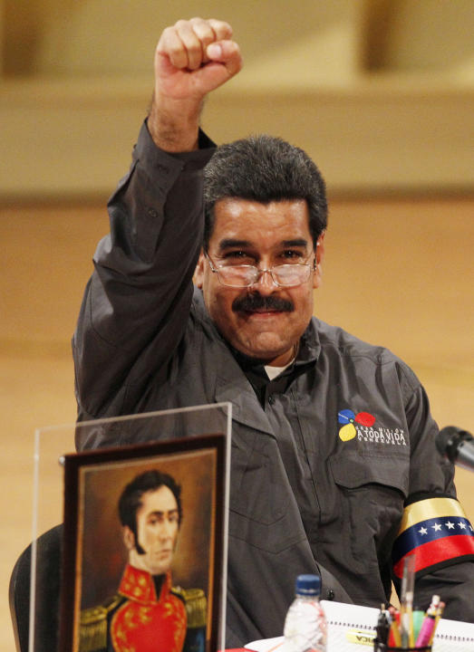 Venezuela's acting President Nicolas Maduro gestures to people at the opening of the Ninth International Book Fair of Venezuela (Filven) which pays tribute to late President Hugo Chavez at the Teresa