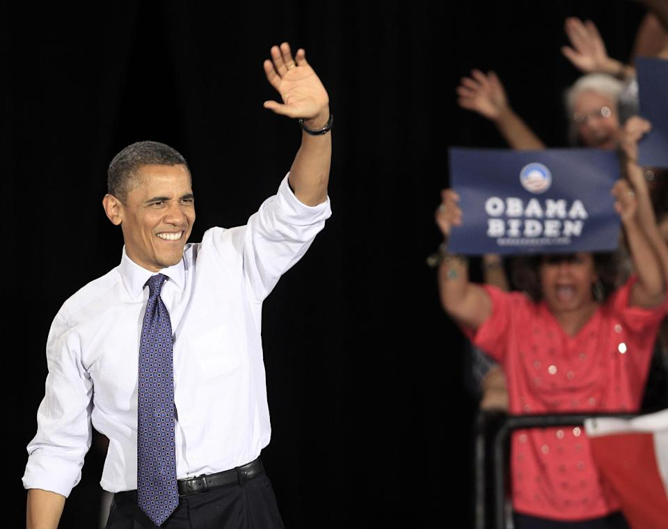President Barack Obama waves after being introduced at the John S. Knight Center Wednesday, Aug. 1, 2012, in Akron, Ohio. Obama is campaign in Ohio with stops in Mansfield and Akron today. (AP Photo/Tony Dejak)