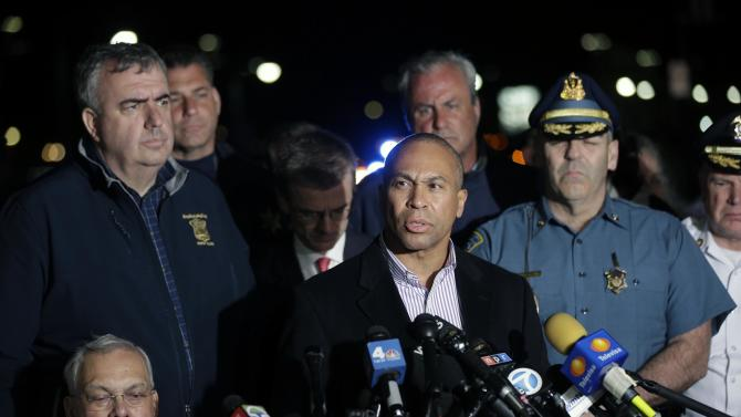 """FILE - In this Friday, April 19, 2013 file photo, Massachusetts Gov. Deval Patrick, at podium, speaks during a news conference, after the arrest of a suspect of the Boston Marathon bombings in Watertown, Mass. Patrick went to his rural home the day after the surviving Boston Marathon bombing suspect was captured and got """"quite drunk"""" alone at a restaurant, he said during a candid conversation at a Boston area marketing firm, Wednesday, June 5, 2013. (AP Photo/Matt Rourke, File)"""