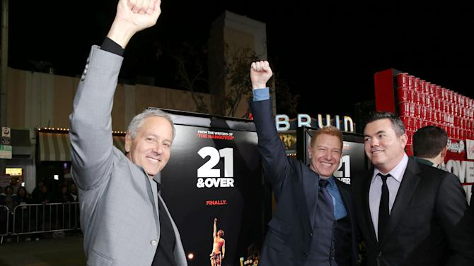 """Producer David Hoberman, Realtivity Media's Ryan Kavanaugh, and Relativity Media's Tucker Tooley at the LA premiere of """"21 and Over"""" at the Westwood Village Theatre on Thursday, Feb. 21, 2013 in Los Angeles. (Photo by Eric Charbonneau/Invision/AP)"""