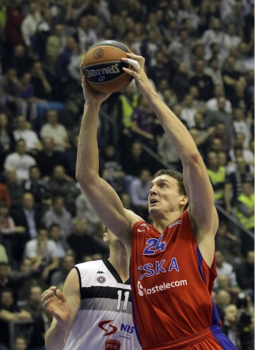 CSKA Moscow's Sasha Kaun, right jumps to shoot as Partizan's Nikola Milutinov tries to stop him during their Round 10, Group A, Euroleague basketball match in Belgrade, Serbia, Thursday, Dec.