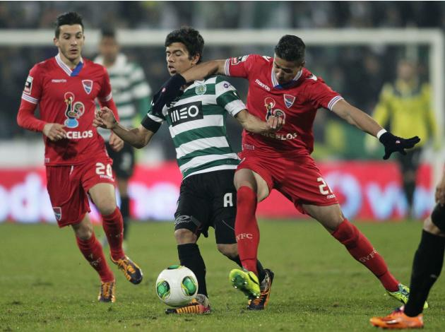 Gil Vicente's Scapolan fights for the ball with Sporting Lisbon's Martins during their Portuguese Premier League soccer match at the Municipal stadium in Barcelos