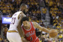 Chicago Bulls guard Derrick Rose (1) drives around Cleveland Cavaliers forward LeBron James (23) during the second half of Game 1 in a second-round NBA basketball playoff series Monday, May 4, 2015, in Cleveland. (AP Photo/Tony Dejak)