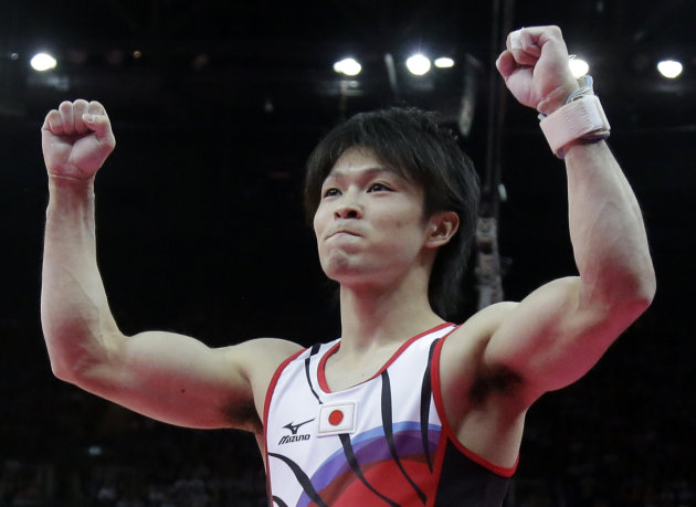 Japanese gymnast Kohei Uchimura gestures after his performance on the pommel horse during the artistic gymnastics men&#39;s individual all-around competition at the 2012 Summer Olympics, Wednesday, Aug. 1, 2012, in London. (AP Photo/Julie Jacobson)