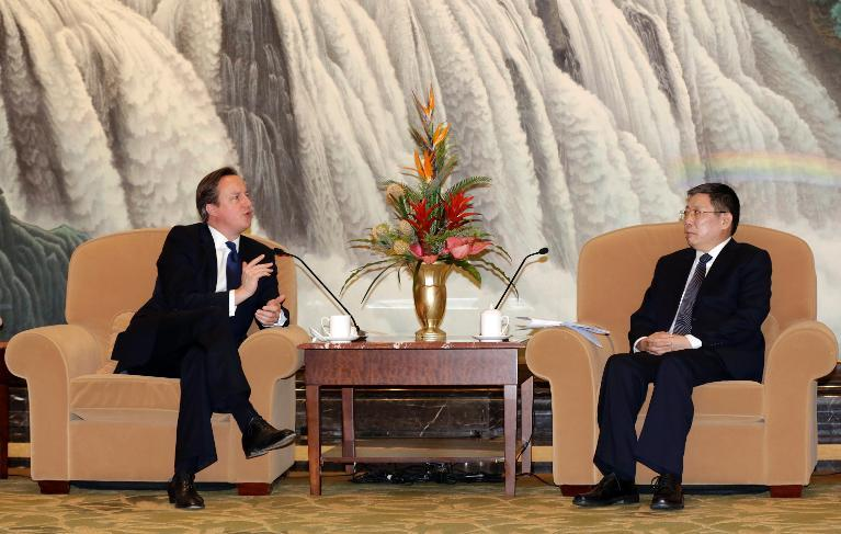 British Prime Minister David Cameron (L) meets with Shanghai Mayor Yang Xiong in Shanghai on December 3, 2013