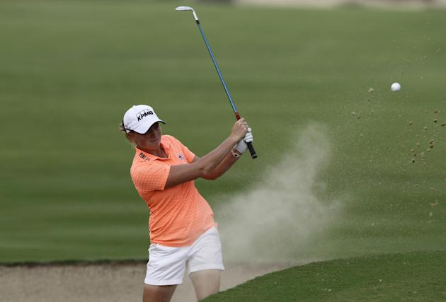 Stacy Lewis of the U.S. plays a bunker shot on the 14th hole during the 2nd round of Dubai Ladies Masters golf tournament in Dubai, United Arab Emirates, Thursday, Dec. 5, 2013