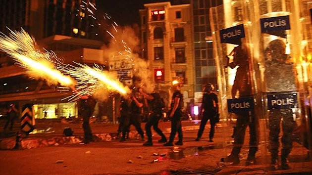 Riot police fire tear gas canisters at protesters in Istanbul's Taksim square June 11, 2013. Turkish riot police using teargas and water cannon battled protesters for control of Istanbul's Taksim Square on Tuesday night (REUTERS)