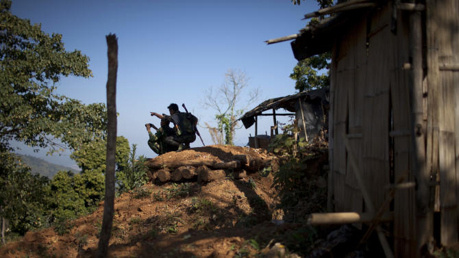 In this Jan. 31, 2013 photo, Kachin Independence Army soldiers observe a hilltop ceased by Myanmar's government troops at an outpost on the Law Hpyu hilltop, one of the last hilltop outposts defending Laiza, where the guerrilla group's headquarters are located, in northern Myanmar's Kachin-controlled region. Kachin state is home to the last rebel insurgency left fighting in Myanmar that hasn't signed a cease-fire with President Thein Sein's government. Although the hills around Laiza have grown quiet for now, the dramatic upsurge in fighting underscored how far Myanmar is from achieving one of the things it needs most - a political settlement to end not just the war with the Kachin, but simmering conflicts with more than a dozen other rebel armies which have plagued the country for decades and still threaten its future. (AP Photo/Alexander F. Yuan)