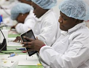Workers assemble Android-based tablets from imported components at the Surtab factory in Port-au-Prince