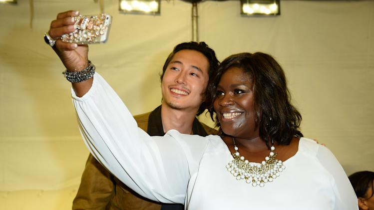EXCLUSIVE - Steven Yeun, left, and Retta attend the mtvU Fandom Awards at MTV Fan Fest at Comic-Con on Thursday, July 24, 2014, in San Diego. (Photo by Jordan Strauss/Invision for MTV/AP Images)