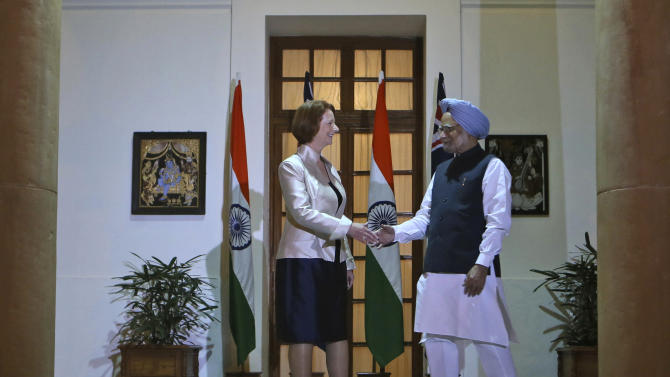Australian Prime Minister Julia Gillard, left, shakes hands with Indian Prime Minister Manmohan Singh before a meeting in New Delhi, India, Wednesday, Oct. 17, 2012. India and Australia began talks Wednesday to strengthen economic and strategic ties and explore cooperation in civilian nuclear energy. (AP Photo/ Manish Swarup)