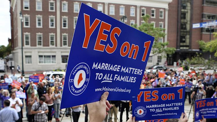 FILE - In this Sept. 10, 2012 file photo, gay marriage supporters gather at a rally outside of City Hall in Portland, Maine, in support of an upcoming ballot question that seeks to legalize same-sex marriage. On one aspect of whether same-sex couples should have the right to marry, both sides agree: The issue defines what kind of nation we are. Half a dozen states and the District of Columbia have made history by legalizing it, but it's prohibited elsewhere, and 30 states have placed bans in their constitutions. (AP Photo/Joel Page, File)
