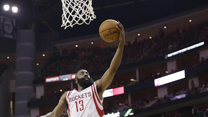 Houston Rockets' James Harden (13) scores over Dallas Mavericks' Monta Ellis (11) during the second half of game 1 in the first round of the NBA basketball playoffs Saturday, April 18, 2015, in Houston. (AP Photo/David J. Phillip)