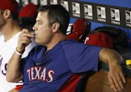Texas Rangers' Lance Berkman looks on from the dugout during the sixth inning of a baseball game against the Los Angeles Angels, Tuesday, July 30, 2013, in Arlington, Texas. (AP Photo/Jim Cowsert)