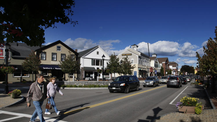 A couple crosses Route 1 in downtown Kennebunk, Maine, Friday, Oct. 12, 2012. Curious residents in this seaside community may have to wait to learn which of their friends and neighbors stand accused of giving business to a fitness instructor charged with running a prostitution operation out of her Zumba studio. The police department's plan to release some of the more than 150 names of suspected clients was delayed Friday by last-minute legal wrangling. Alexis Wright, a 29-year-old fitness instructor from Wells, Maine, has pleaded not guilty to prostitution, invasion of privacy and other charges for allegedly accepting money for sex and secretly videotaping her encounters. Her business partner, Mark Strong Sr., a 57-year-old insurance agent and private investigator from Thomaston, Maine, pleaded not guilty to 59 misdemeanor charges.(AP Photo/Robert F. Bukaty)