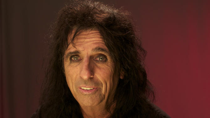 "In this Aug. 22, 2011 photo, musician Alice Cooper is shown in New York. Cooper is promoting next month's release of ""Welcome 2 My Nightmare,"" the follow up to his 1975 album. (AP Photo/John Carucci)"