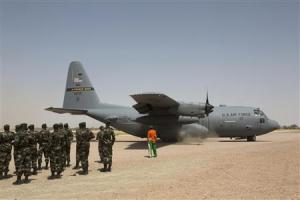 A C-130 U.S. Air Force plane lands as Nigerien soldiers …