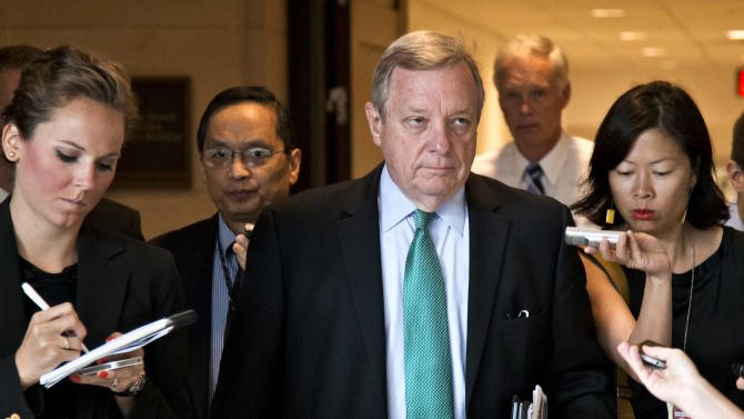 FILE - This Sept. 4, 2013 file photo shows Sen. Dick Durbin, D-Ill., the Senate assistant majority leader, arriving for a top-secret briefing for senators with Secretary of State John Kerry at the Capitol in Washington. On Monday, Oct. 28, 2013 in Chicago, Durbin says he had no problem taking down a Facebook post disputed by the Obama administration once White House officials acknowledged giving him wrong information. (AP Photo/J. Scott Applewhite, File)