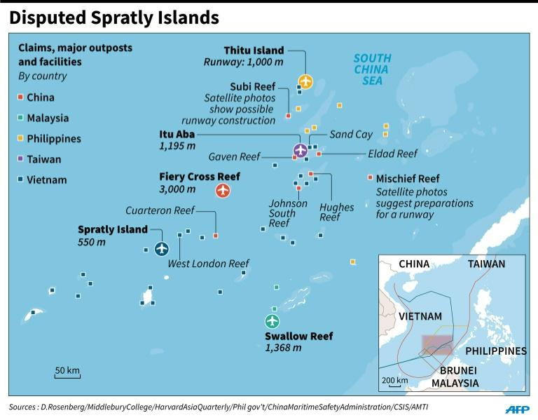 spratly islands dispute in the south Chinese soldiers on the spratly islands, known in china as the nansha islands, in february the sign at the right reads, nansha is our the chinese government says that washington should play no part in trying to settle the territorial disputes in the south china sea, and it has criticized operations by.