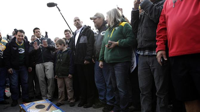 Republican vice presidential candidate, Rep. Paul Ryan, R-Wis., second from left, plays corn hole with Gov. Scott Walker, left, R-Wis., and his son Charlie at a tailgate party for the football game between the Green Bay Packers and the Arizona Cardinals at  Lambeau Field, Sunday, Nov. 4, 2012, in Green Bay , Wis.  (AP Photo/Mary Altaffer)